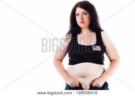 Young Overweight American Woman Trying To Zip Up Jeans