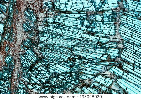 Broken car windshield made of laminated glass. Texture. Background.