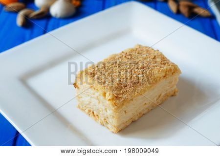 Napoleon Or Millefeuille Cake Close Up Sliced On Square Plate