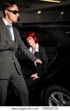 bodyguard reaching for his gun, defending the godfather's daughter as she is getting out of the car