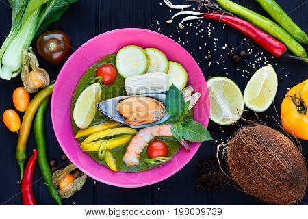 Traditional Thai Tom Yam Soup With Vegetables, Lime, Squid, Shri