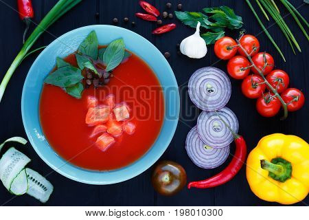 Spanish Soup Gazpacho With Salmon And Basil Leaves In Blue Plate