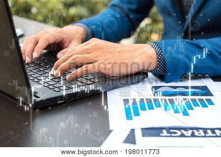 Business Trading Concept : Man Trade Stock And Forex By Laptop And Analysis Market Financial Data