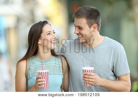Couple Flirting And Holding Takeaway Refreshments