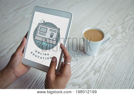 Digital composite of Person holding a tablet with e-learning information in the screen