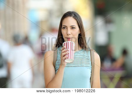 Woman Drinking A Takeaway Refreshment