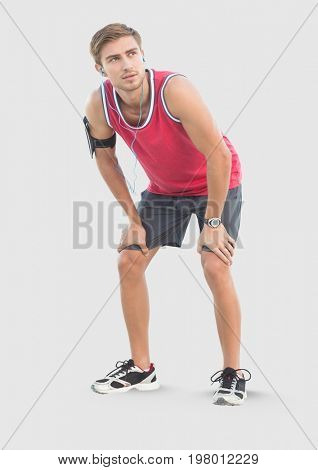 Digital composite of Full body portrait of athletic Man standing with grey background