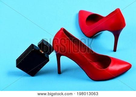 Pair Of Female Shoes In Red Color And Perfume Bottle