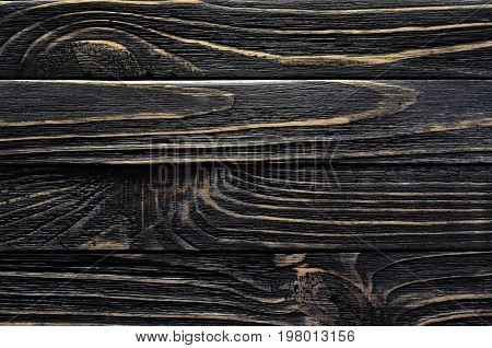 Old Weather-worn Wood Board with Grains and Gnarls. Dark Wood Texture Close-Up