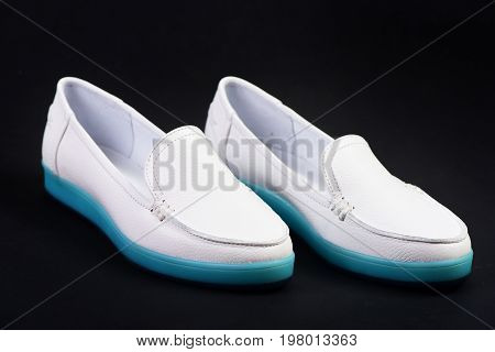 Casual Sports Footwear For Women. Pair Of Female Leather Shoes