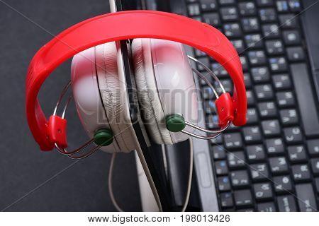 Electronics On Grey Background. Headphones And Black Laptop
