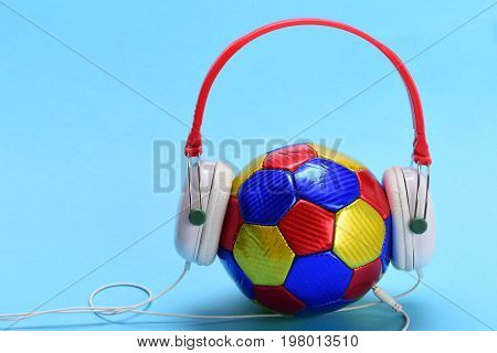 Headphones In White And Red Color With Colorful Soccer Ball