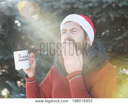 Yawning Man In Santa Hat