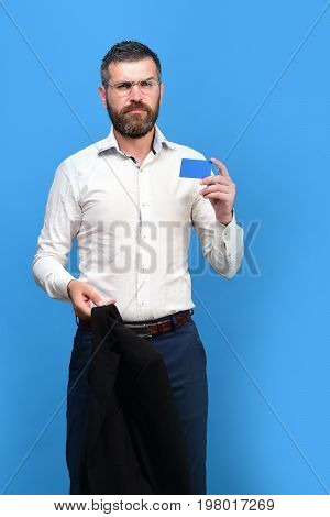 Guy With Thoughtful Face And Glasses On Blue Background