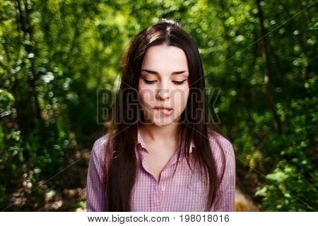 Portrait Of Attractive Young Indecisive Shy Woman Face Close Up
