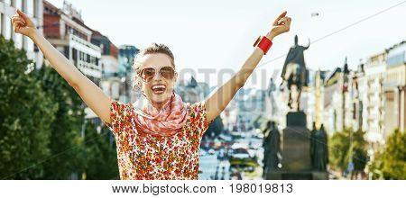 Tourist Woman On Wenceslas Square In Prague Rejoicing