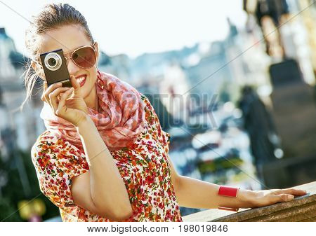 Tourist Woman With Digital Camera Taking Photo In Prague