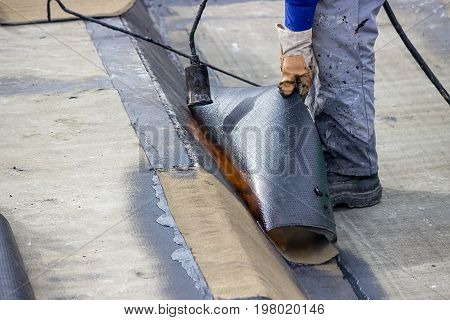 Worker Heating And Melting Bitumen Felt 2
