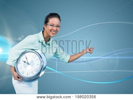 Digital composite of Woman holding clock in front of blue curved background