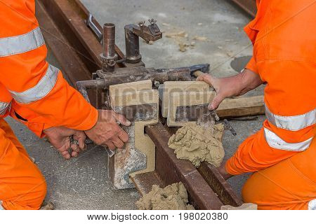 Worker Installing Mould And Using Mould Material 2