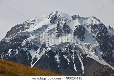 Rocky of mountain peaks glaciers snowfields and traces of avalanches in the Tien Shan Kyrgyzstan.