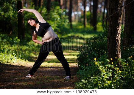 Young Overweight Woman Working Out In The Park