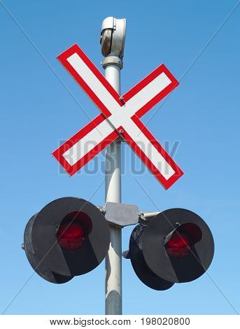 road intersection railroad track x sign caution crossing safety