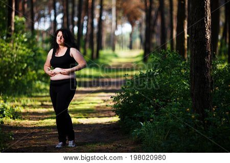 Overweight Woman Demonstrating Her Belly