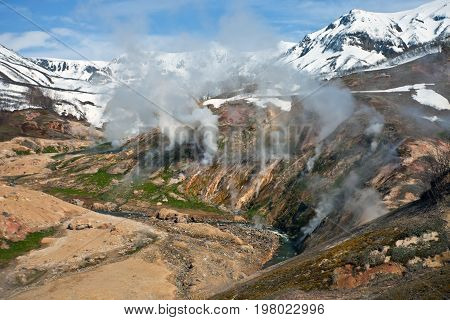 Mountainous terrain and gas emissions in the Valley of Geysers in Kamchatka. The plot of the volcanic and thermal activities in the Kronotsky nature reserve. Russia.
