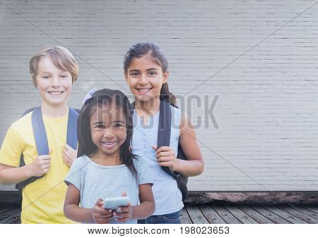 Digital composite of Kids in front of blank wall