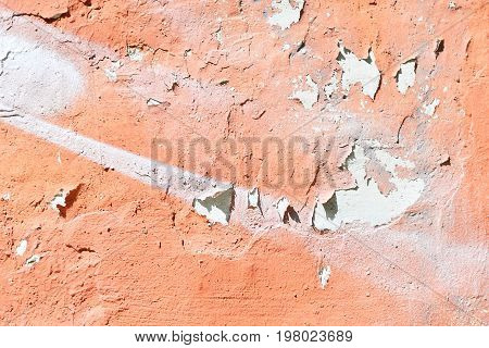 The wall and the paint cracked. Fragment requiring repair