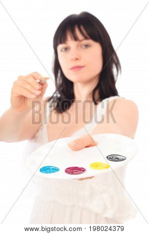 Studio shot of a painter with CMYK palette