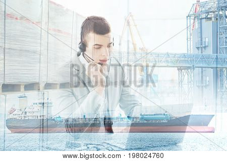 Double exposure of seaport and businessman with laptop. Wholesale and logistic concept