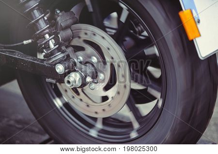 Rear Motorcycle Brake Disc In Motion, The Wheel Rotates