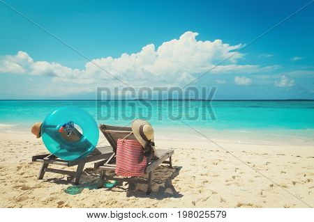 family at beach -two beach chairs on tropical vacation