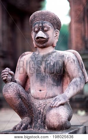 Ancient stone figure of Garuda in Banteay Srey Temple in Angkor Area, Cambodia. Banteay Srey is a 10th century Cambodian temple dedicated to the God Shiva.