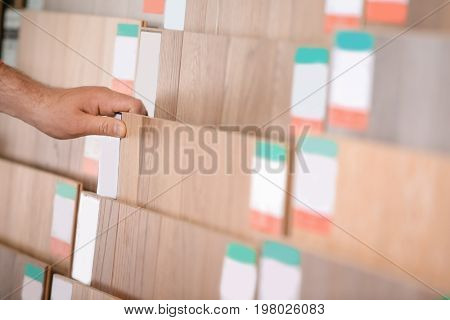 Man choosing laminate samples in hardware store