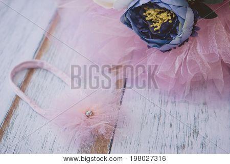 Pink Tu-tu Skirt For Newborn Babies And Headband Close-up On Wooden Plank Floor