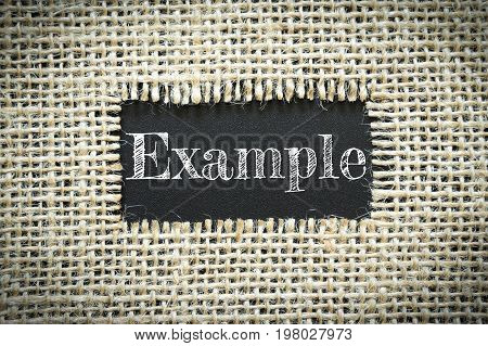 Text Example on paper black has Cotton yarn background you can apply to your product.