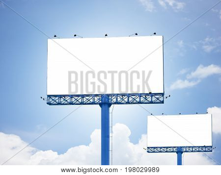 Blank billboard advertisement on blue sky background for adding Ad pictures or Advertising to white area billboards