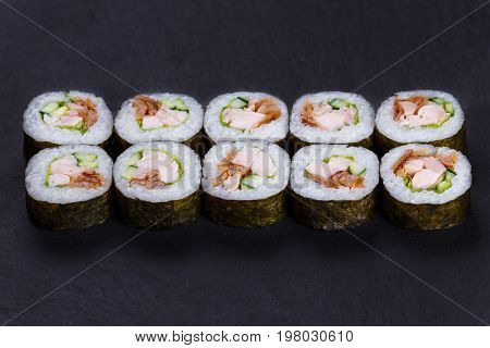 Futomaki Sushi Roll With Redfish, Omelet And Cucumber Served On