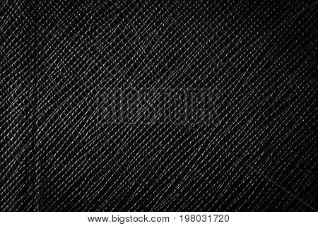 Black background with spotlight. black leather texture background surface.