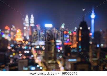 Blurred abstract background lights beautiful cityscape view of Kuala lumpur city skyline at night in Malaysia.