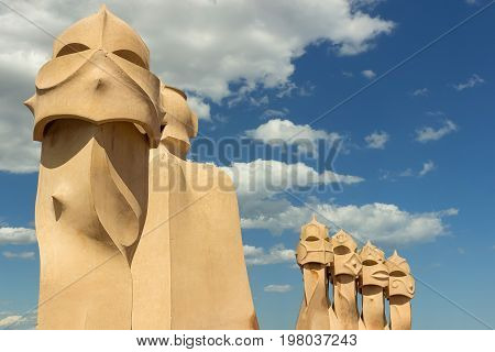 BARCELONA SPAIN - July 9 2017: Roof and chimneys of Casa Mila - La Pedrera. Casa Mila is a modernist building in Barcelona was designed by Catalan architect Antoni Gaudi