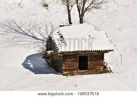 Winter landscape with a wooden hut in the mountains in Bucegi. Romania Carpathian Mountains