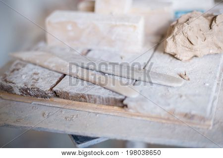 The Sculptor's Tools Lie On A Wooden Board. Horizontal Frame