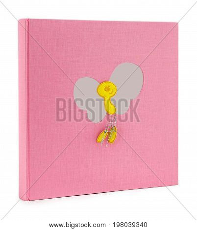 Photo book for a newborn on a white background. Photo album standing at an angle on isolated background