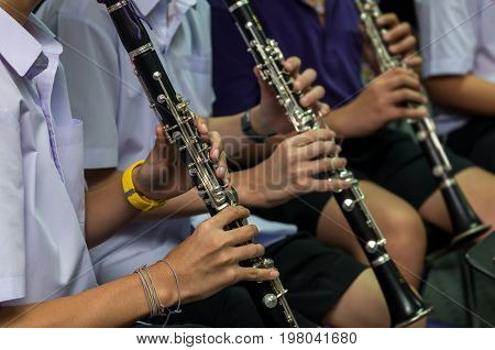 Close up of Clarinetist performance which is some part of classic music band when rehearsal musical concept