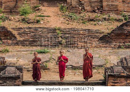 Three Buddhist novice are praying at Mingun Pahtodawgyi bagan mandalay myanmar