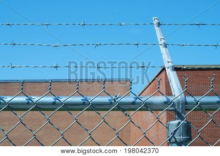 iron metal fence barbed wire boundary security protection prohibited zone